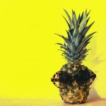 green-pineapple-fruit-with-brown-framed-sunglasses-beside-1161547